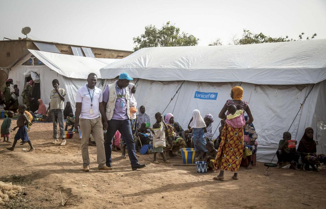 UNICEF field staff at a newly created displacement site in Sevare. Following the mass displacement of families from Bankass and Bandiagara, UNICEF is supporting IDP sites in Mopti and Sevare through tents and other basic supplies, as well support to mass vaccination campaigns.