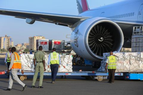 supplies being offloaded from a plane