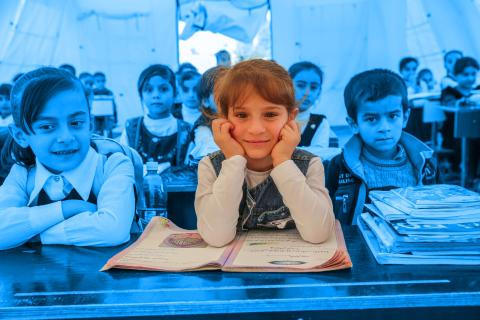 a girl sitting in a classroom