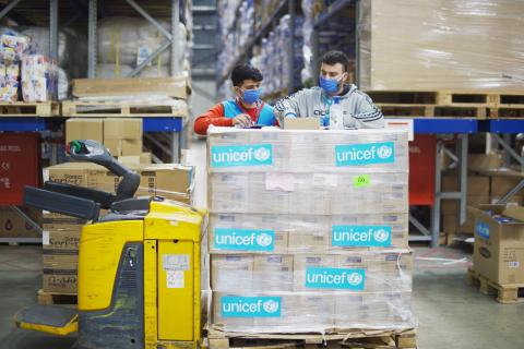 two workers in a supply warehouse