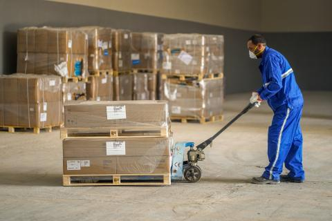 a man moving packages in a warehouse