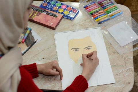 A girl drawing a face