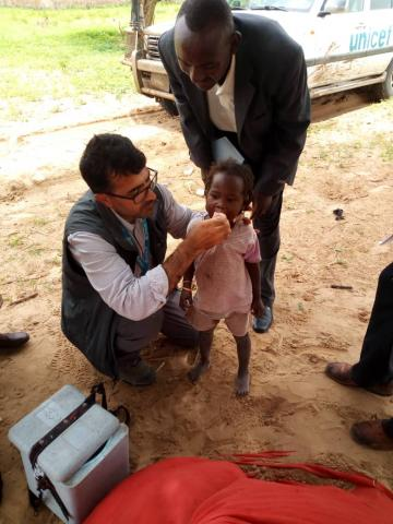 A young girl getting a polio vaccination
