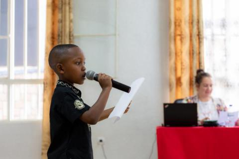 a boy speaking into a microphone