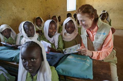 UNICEF Executive Director sitting with students in class