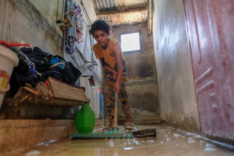 a girl cleaning the floor