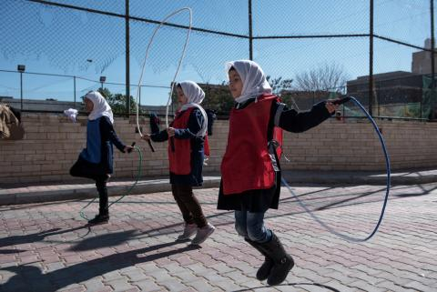Girls playing with jump ropes
