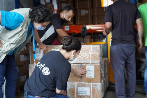 workers checking and labeling supplies