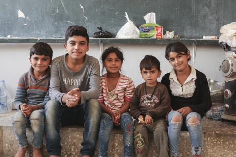 a group of displaced kids in a class room