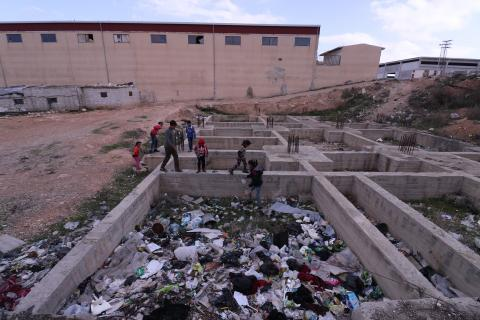 kids searching through garbage piles