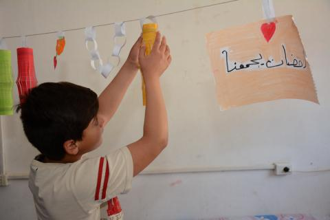 a boy hanging decorations