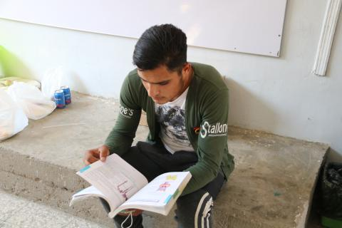 a young adult guy studying