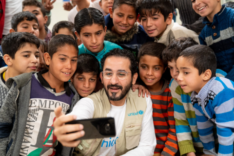 Ahmed Helmy taking a selfie with children