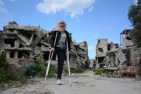 a girl standing using crutches