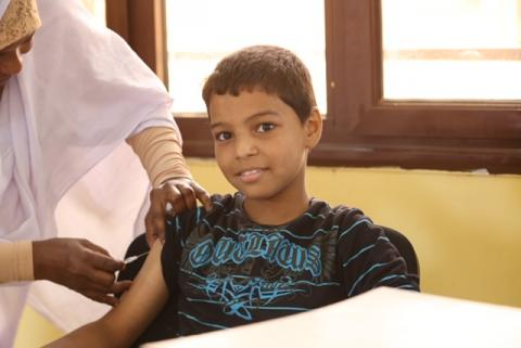 A boy being vaccinated