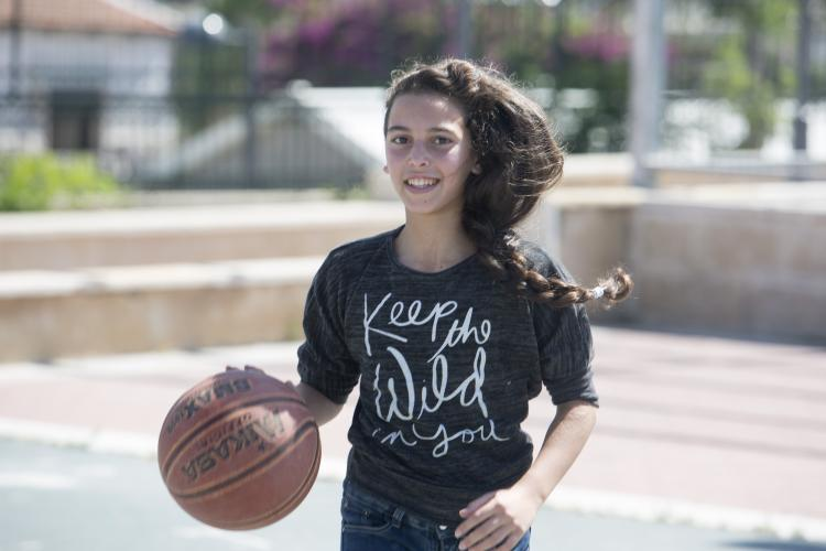 A girl playing Basketball