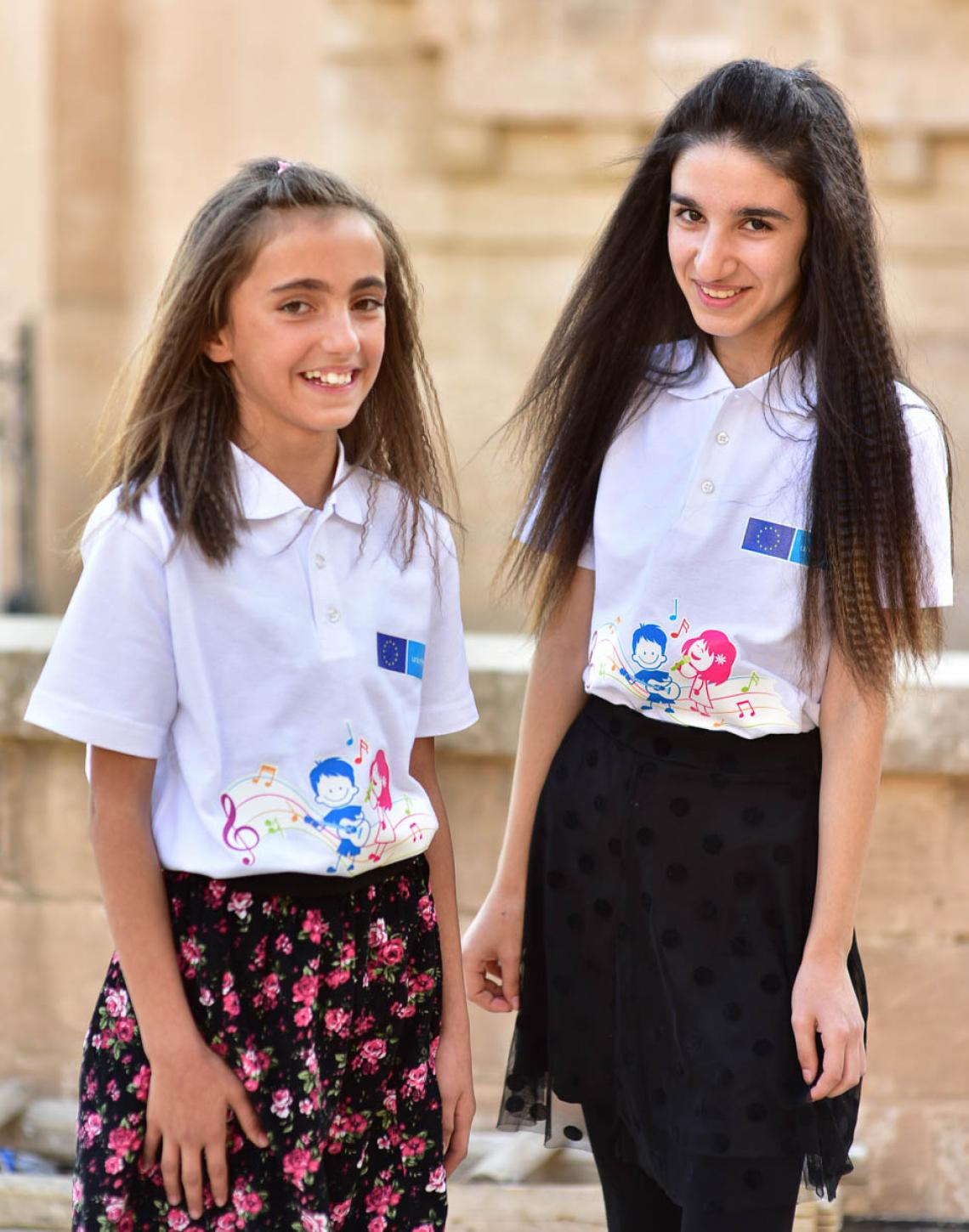 Two girls smiling to the camera
