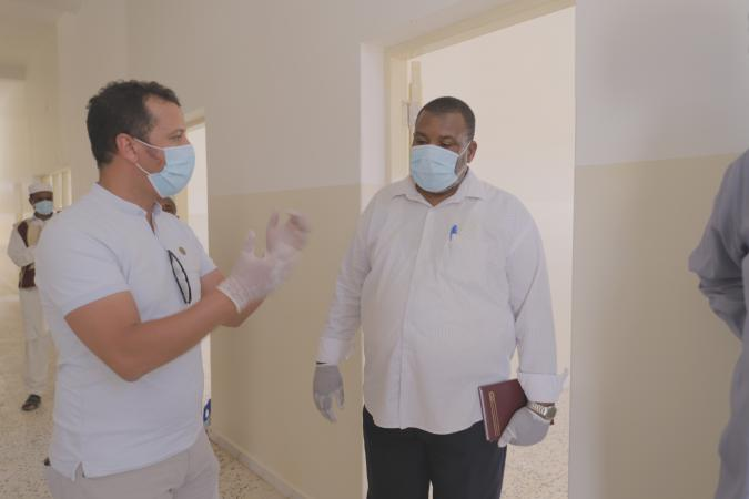 Two men in surgical masks