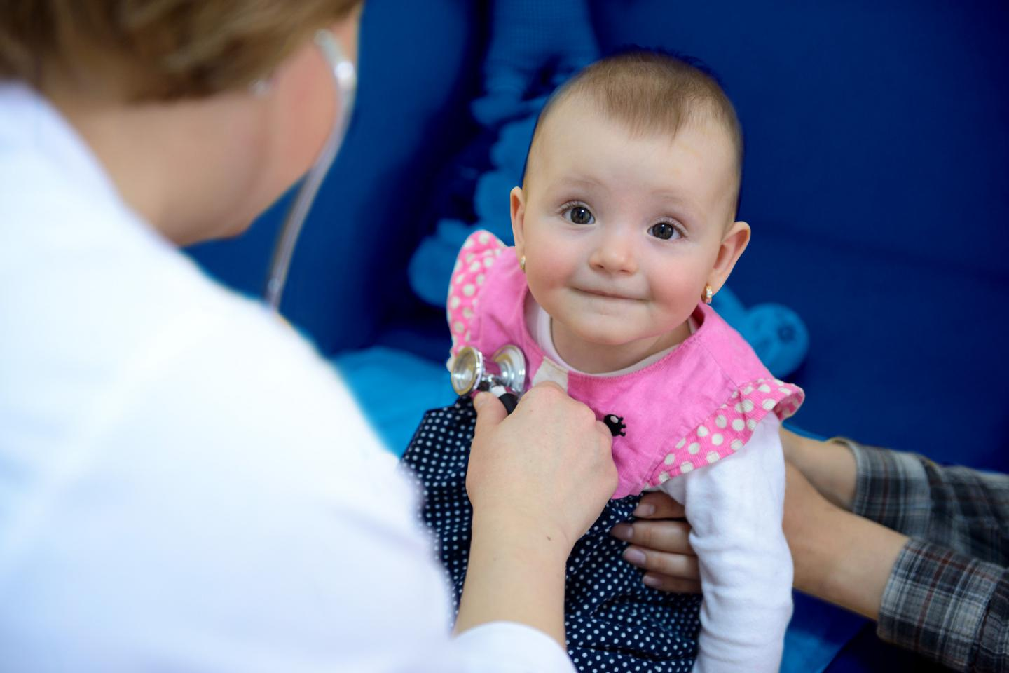 young child with a health specialist, Moldova