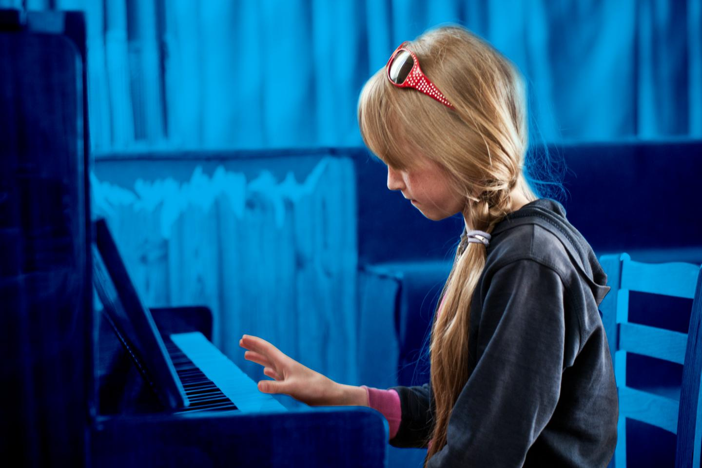 girl playing piano in a residential institution, Moldova