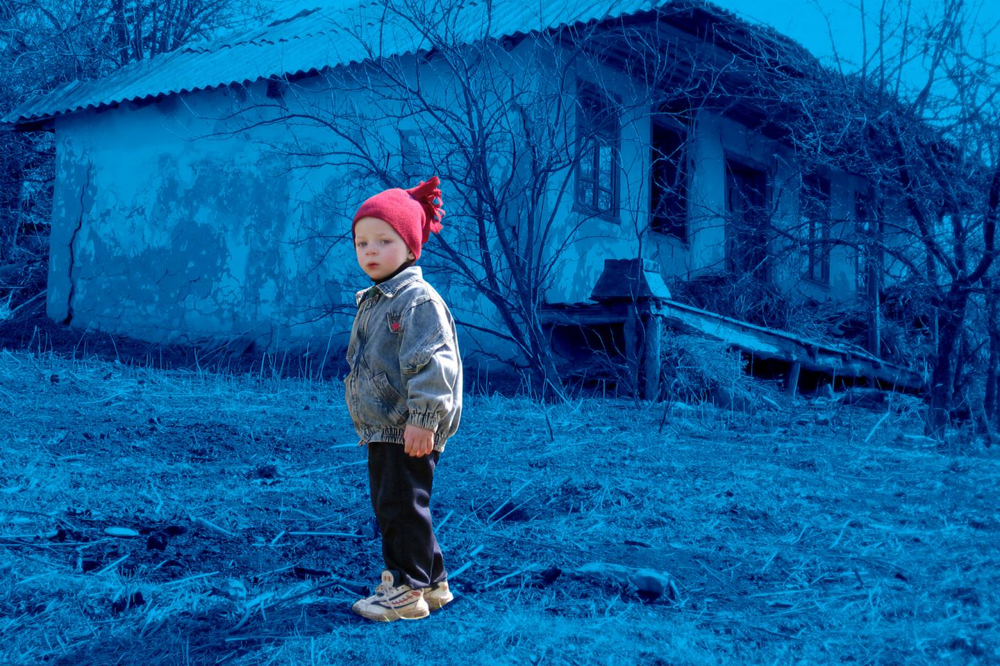 child in a red beanie, Moldova