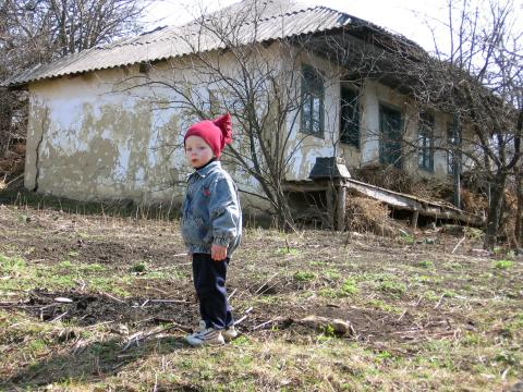 Rural child in red hat