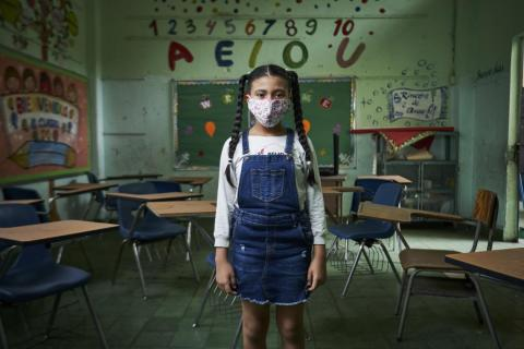 A student stands in an empty classroom in Panama City, Panama.