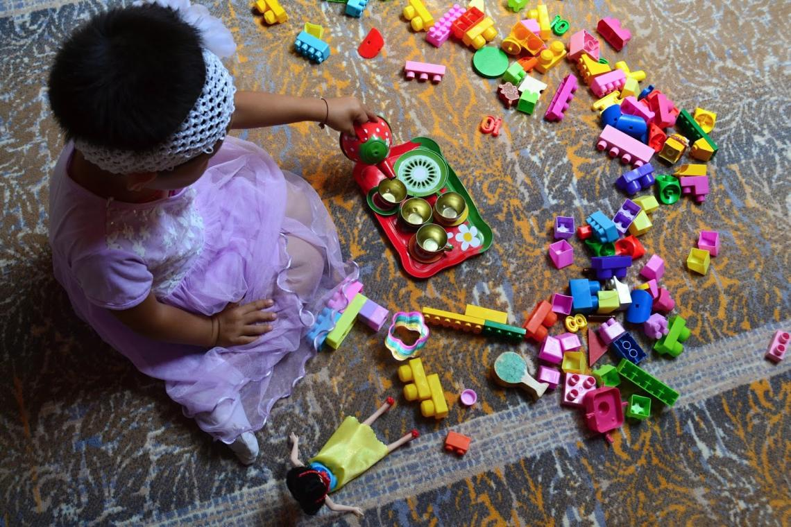 Five-year-old Minjinsor is playing with her favorite toys at the ger kindergarten.
