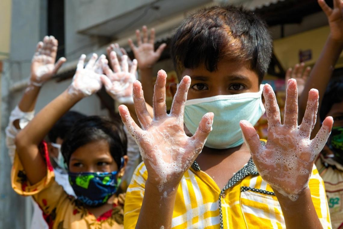 Children wash their hands at a Global Hand Washing Day event organized by UNICEF Bangladesh in Dhaka.
