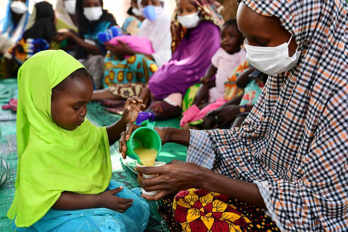 Mothers and their babies take part in a nutrition activity in their community in Bertoua, Cameroon.