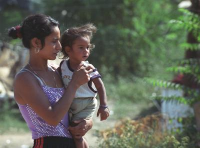 A Roma girl with a baby in her arms
