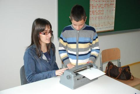 Andjela explaining the Braille alphabet and showing how to type it to students of a mainstream primary school in Montenegro