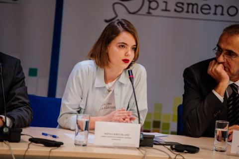 Young reporter Sofija at a press conference