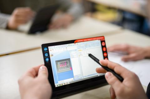 graphs showing data on a tablet used by a student in the school