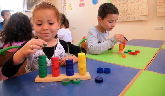 Children in a classroom building blocks
