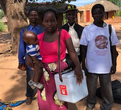 Ciosa Antonio and her colleagues from the vaccination team in front of the health center of Massira