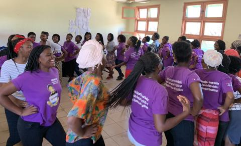 Girls from Nampula province dance during a training session as part of the Rapariga Biz Program.