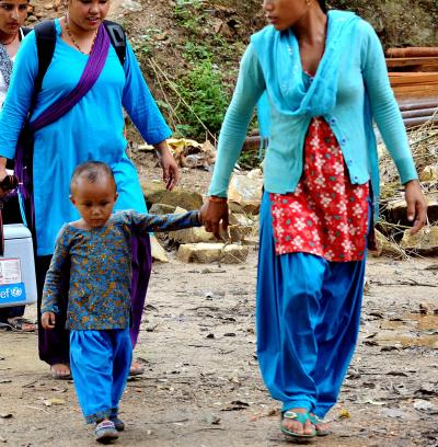 mother and son walking to get vaccination