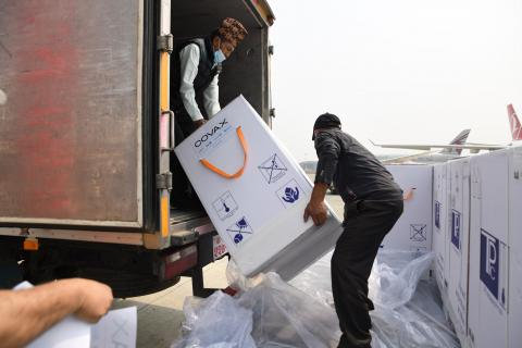 This image shows COVAX vaccines being unloaded at the Tribhuvan International Airport in Kathmandu