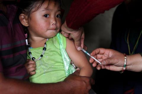 A girl getting vaccinated