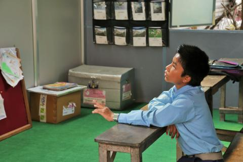 Almost always early to class, Thakur sits observing the charts and materials on the walls of his new classroom