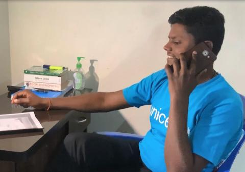 This image shows UNICEF staff member Indra Raj Pant talking on the phone