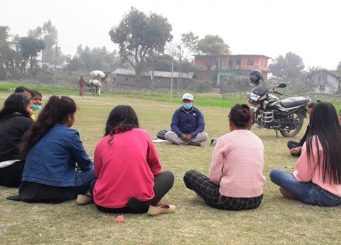 This image shows psychosocial counsellor Laxman BK conducting a session with adolescents