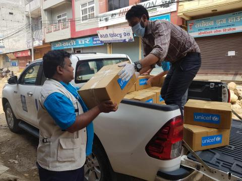 This image shows UNICEF staff unloading supplies provided by UNICEF to the government's Provincial Health Logistics Management Center in Butwal in Rupandehi District in Nepal's west as part of the COVID-19 response.