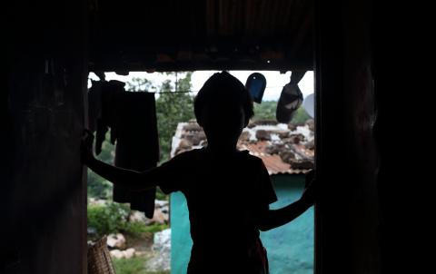 This image shows the silhouette of a child