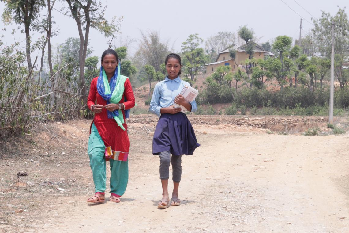 Rejina Nepali (right) walks home from school with mother Belmati (left) in Tulsipur, Dang District