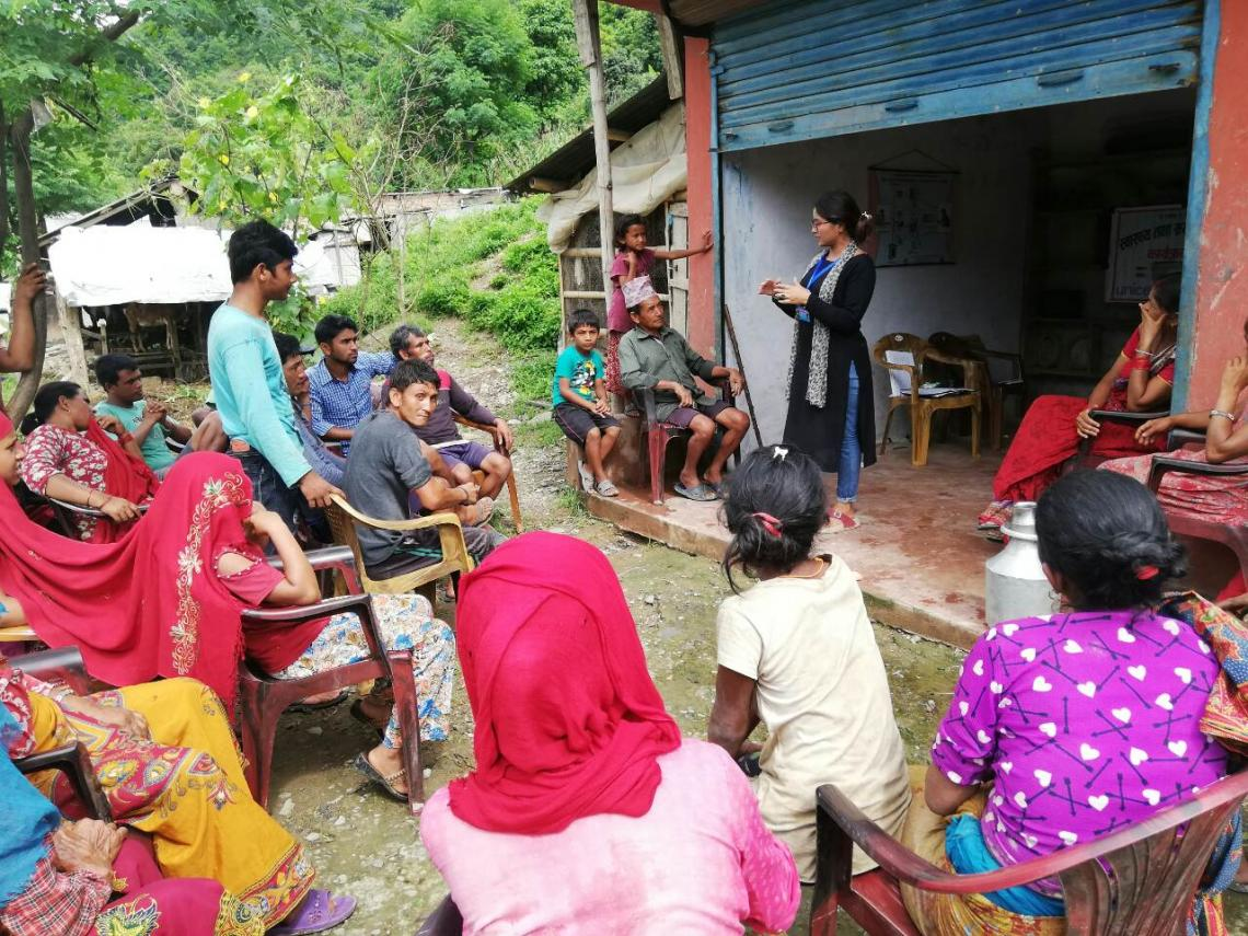 Goma orients community members in Gorkha District on improved water and sanitation practices.