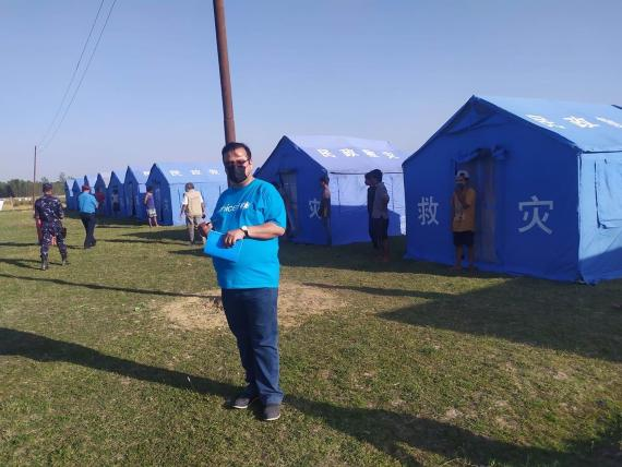 This image shows a UNICEF staff member during a monitoring visit– conducted together with representatives of the government and security forces and other partner - to the quarantine site set up on the Nepal-India border in Banke District to house recent returnees from India.