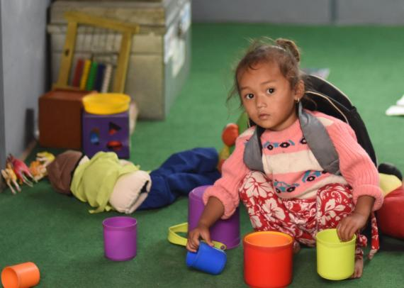 This image shows a young child in her ECD classroom