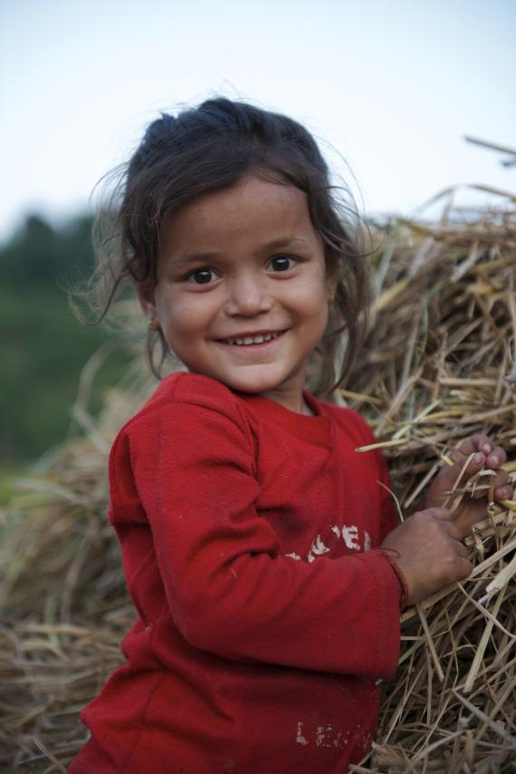 A little girl smiles at the camera